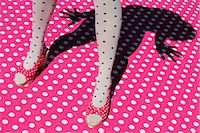 stocking feet - Woman Wearing Polka Dot Tights and Shoes Standing on Polka Dot Surface Stock Photo - Premium Rights-Managednull, Code: 700-03623023