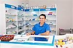 latino pharmacist at counter Stock Photo - Premium Royalty-Free, Artist: Masterfile, Code: 673-03623215