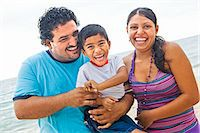 portrait of young mexican family Stock Photo - Premium Royalty-Freenull, Code: 673-03623238