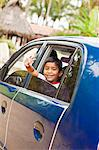 young mexican boy in car Stock Photo - Premium Royalty-Free, Artist: Jerzyworks, Code: 673-03623241