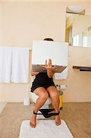 woman on laptop in bathroom Stock Photo - Premium Royalty-Freenull, Code: 673-03623291