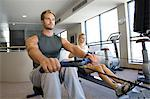 Man and Woman Working Out In Gym Stock Photo - Premium Royalty-Freenull, Code: 621-03623419