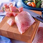 Raw fillet of perch on chopping board with knife Stock Photo - Premium Rights-Managed, Artist: Photocuisine, Code: 825-03627042