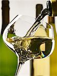 Pouring a glass of white wine Stock Photo - Premium Rights-Managed, Artist: Photocuisine, Code: 825-03628263
