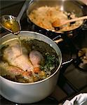 Basting the meat with the chicken stock Stock Photo - Premium Rights-Managed, Artist: Photocuisine, Code: 825-03629072