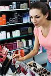 Young woman browsing cosmetics in store Stock Photo - Premium Royalty-Free, Artist: Jon Arnold Images, Code: 632-03629975