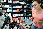 Young woman browsing cosmetics in store Stock Photo - Premium Royalty-Free, Artist: Michael Mahovlich, Code: 632-03629991