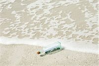 Message in a bottle washed up on shore Stock Photo - Premium Royalty-Freenull, Code: 632-03630253