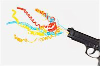 streamer - tapes and toy gun Stock Photo - Premium Royalty-Freenull, Code: 618-03631311
