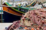 Fishing net and boat in harbor of Marsalforn, Gozo, Malta Stock Photo - Premium Royalty-Free, Artist: Robert Harding Images, Code: 618-03632120
