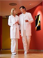 Doctors talking in corridor of clinic Stock Photo - Premium Royalty-Freenull, Code: 618-03632444