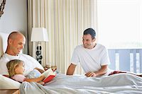 Two Men reading to Young Girl in bed. Stock Photo - Premium Royalty-Freenull, Code: 618-03632876