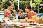 Woman and two kids at table laughing Stock Photo - Premium Royalty-Free, Artist: Cultura RM, Code: 618-03633062