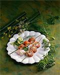 Sliced smoked salmon rolls on skewers Stock Photo - Premium Royalty-Freenull, Code: 652-03635833