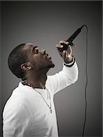 Young Man Singing Stock Photo - Premium Royalty-Freenull, Code: 600-03638853