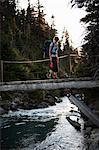 Woman Hiking Across Bridge, Garibaldi Provincial Park, British Columbia, Canada Stock Photo - Premium Royalty-Free, Artist: Grant Harder, Code: 600-03641246