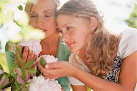 Mother and daughter smelling flowers Stock Photo - Premium Royalty-Freenull, Code: 635-03641518