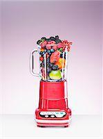 Variety of fruit crammed in blender Stock Photo - Premium Royalty-Freenull, Code: 635-03641699