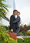 Smiling businessman and businesswoman hugging outside office building Stock Photo - Premium Royalty-Freenull, Code: 635-03641987
