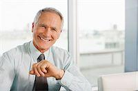 Smiling businessman Stock Photo - Premium Royalty-Freenull, Code: 635-03641992