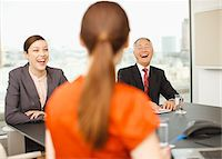 Business people laughing in conference room Stock Photo - Premium Royalty-Freenull, Code: 635-03642010