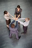 Business people standing in circle with hands stacked Stock Photo - Premium Royalty-Freenull, Code: 635-03642041