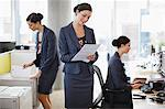 Sequence of businesswoman working in office Stock Photo - Premium Royalty-Freenull, Code: 635-03642048
