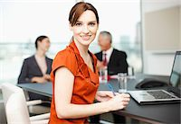 Smiling businesswoman with laptop in conference room Stock Photo - Premium Royalty-Freenull, Code: 635-03642068