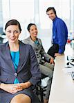 Smiling business people in office Stock Photo - Premium Royalty-Freenull, Code: 635-03642076