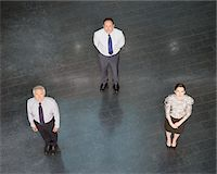 Business people standing in triangle Stock Photo - Premium Royalty-Freenull, Code: 635-03642101