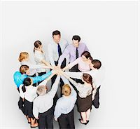 Business people in circle stacking hands Stock Photo - Premium Royalty-Freenull, Code: 635-03642106
