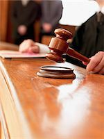 Close up of judge raising gavel in courtroom Stock Photo - Premium Royalty-Freenull, Code: 635-03642119