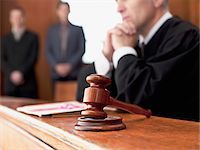 Judge and gavel in courtroom Stock Photo - Premium Royalty-Freenull, Code: 635-03642120