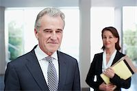 Smiling business people in office Stock Photo - Premium Royalty-Freenull, Code: 635-03642181