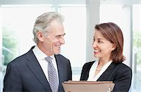 Smiling business people with files Stock Photo - Premium Royalty-Freenull, Code: 635-03642184