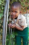 Young schoolboy drinking water from a tap, KwaZulu Natal Province, South Africa Stock Photo - Premium Royalty-Free, Artist: Raoul Minsart, Code: 682-03643887