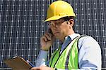 Maintenance worker with photovoltaic array in Los Angeles, California Stock Photo - Premium Royalty-Free, Artist: Aflo Relax, Code: 693-03643955