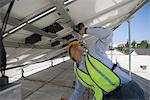 Maintenance worker adjusting solar panel in Los Angeles, California Stock Photo - Premium Royalty-Free, Artist: UpperCut Images, Code: 693-03643959