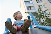 Young boy in playground Stock Photo - Premium Royalty-Freenull, Code: 693-03644039