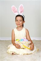 Young girl (4-5) in easter bunny costume, portrait Stock Photo - Premium Royalty-Freenull, Code: 618-03644227