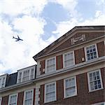 Jet Flying Over Building, London, England Stock Photo - Premium Rights-Managed, Artist: Michael Filonow, Code: 700-03644346