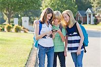Group of Friends with Cell Phone Going to School Stock Photo - Premium Rights-Managednull, Code: 700-03644534