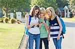 Group of Friends with Cell Phone Going to School