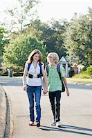 preteen girl boyfriends - Boy and Girl Walking and Holding Hands Stock Photo - Premium Rights-Managednull, Code: 700-03644535