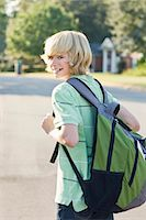 Boy Walking with Backpack Stock Photo - Premium Rights-Managednull, Code: 700-03644536