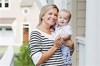 Mother and Son Outside of Home Stock Photo - Premium Rights-Managednull, Code: 700-03644557