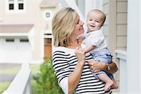 Mother and Son Outside of Home Stock Photo - Premium Rights-Managednull, Code: 700-03644558