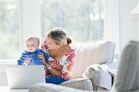 Mother and Son at Home Using Laptop Stock Photo - Premium Rights-Managednull, Code: 700-03644559