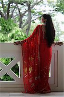 singapore traditional costume lady - Back shot of Indian woman wearing a red sari looking over balcony. Stock Photo - Premium Rights-Managednull, Code: 849-03644989