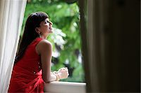 singapore traditional costume lady - Indian woman looking out window, smiling Stock Photo - Premium Rights-Managednull, Code: 849-03645373